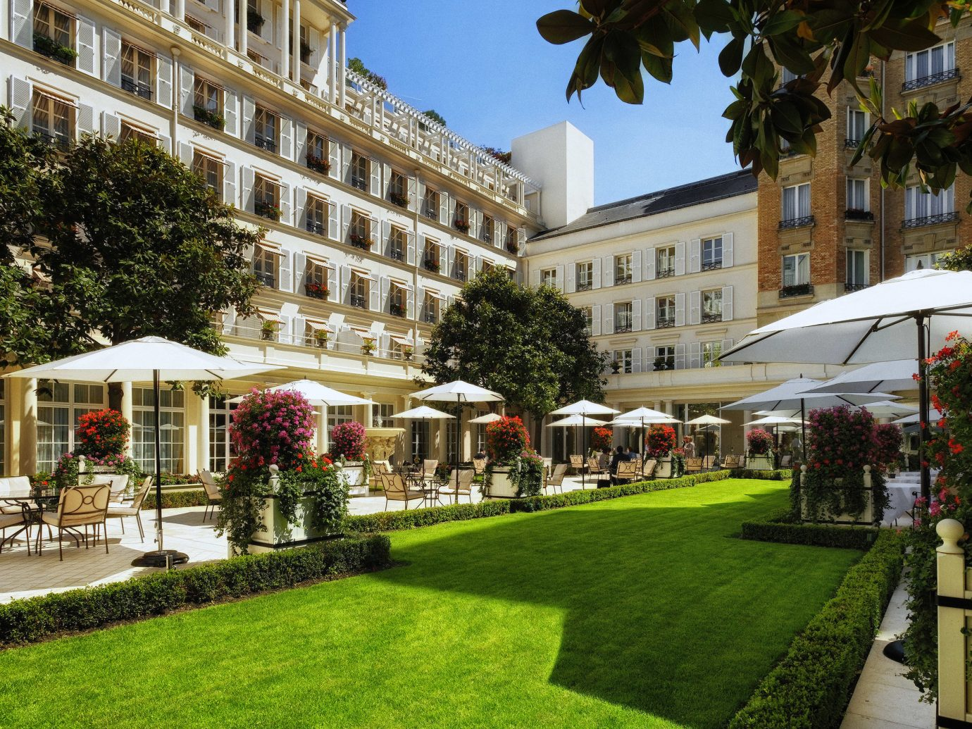 France Hotels Paris grass tree outdoor building mixed use Resort estate real estate City hotel plant plaza palm tree park arecales mansion condominium Courtyard lawn government building