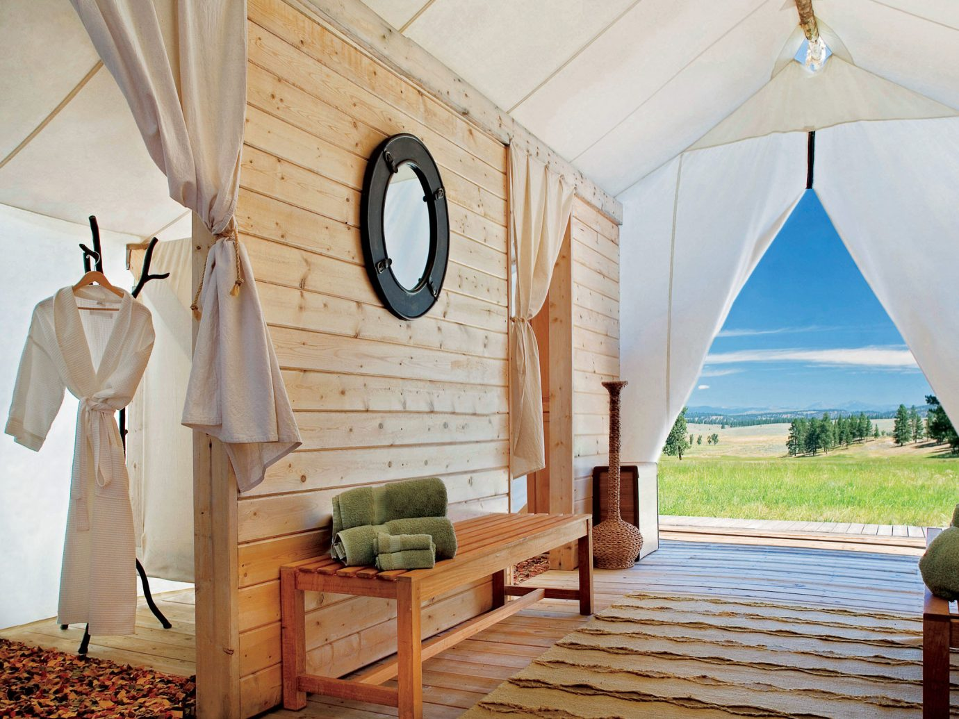 Glamping Luxury Travel Outdoors + Adventure indoor room house home estate cottage interior design wood farmhouse Villa living room furniture stone