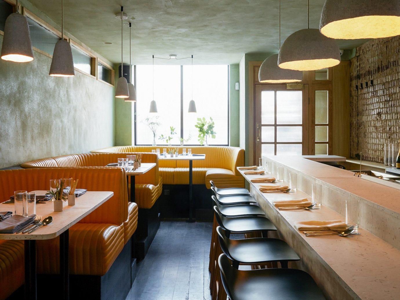 Food + Drink London table indoor floor restaurant interior design Architecture wooden Dining café furniture wood area several