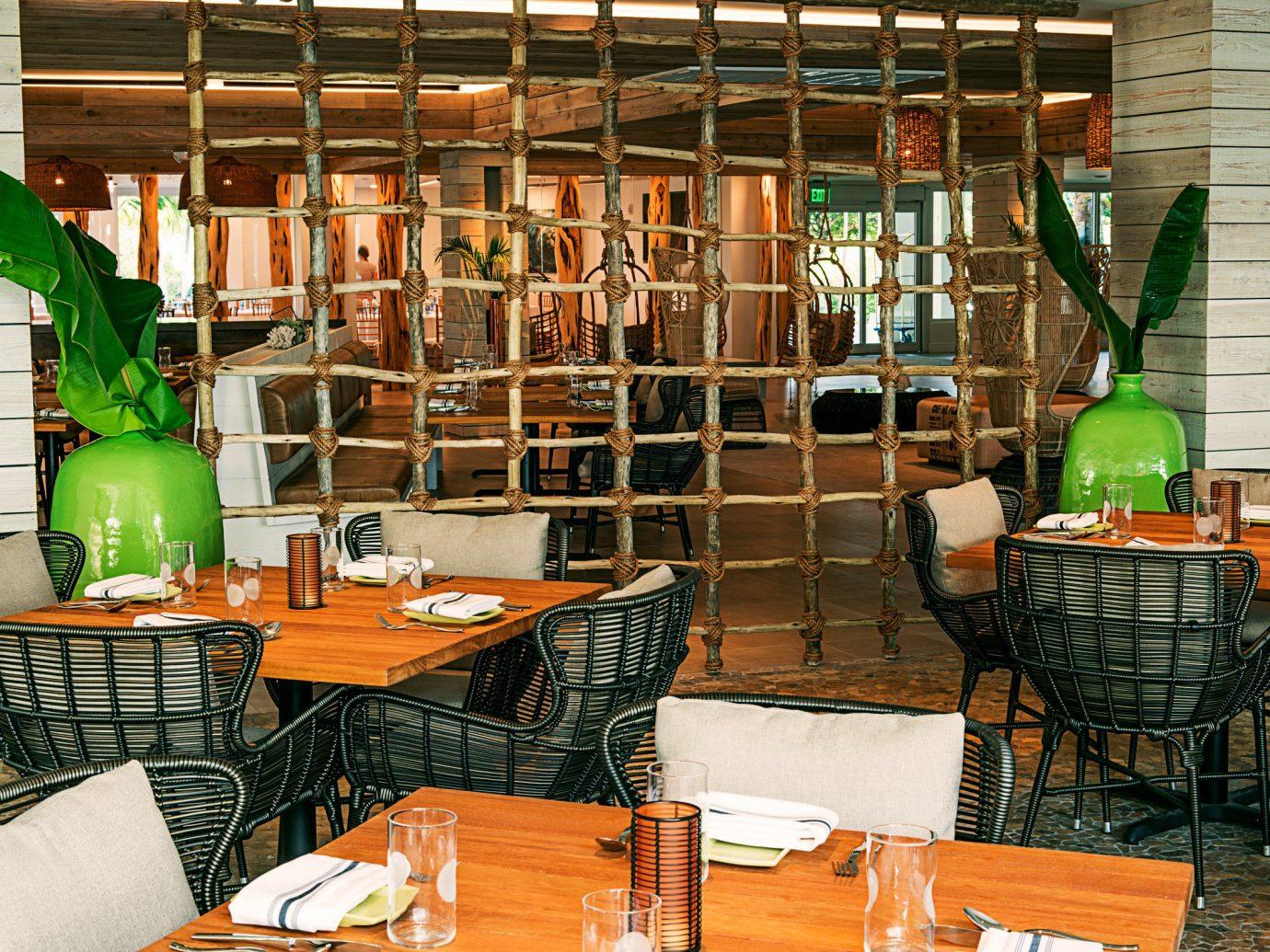 Beach Beachfront Dining Hotels Resort chair room building home restaurant interior design Design meal area furniture