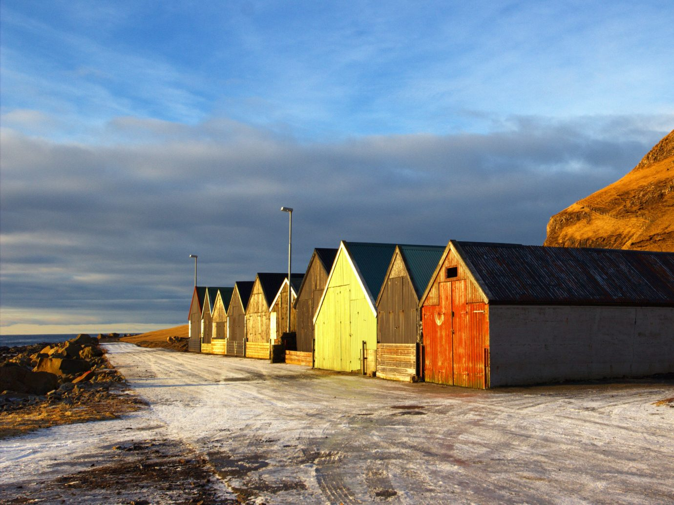 Trip Ideas sky yellow cloud morning Winter evening horizon snow house Sea Coast arctic mountain landscape sand ice cottage hut