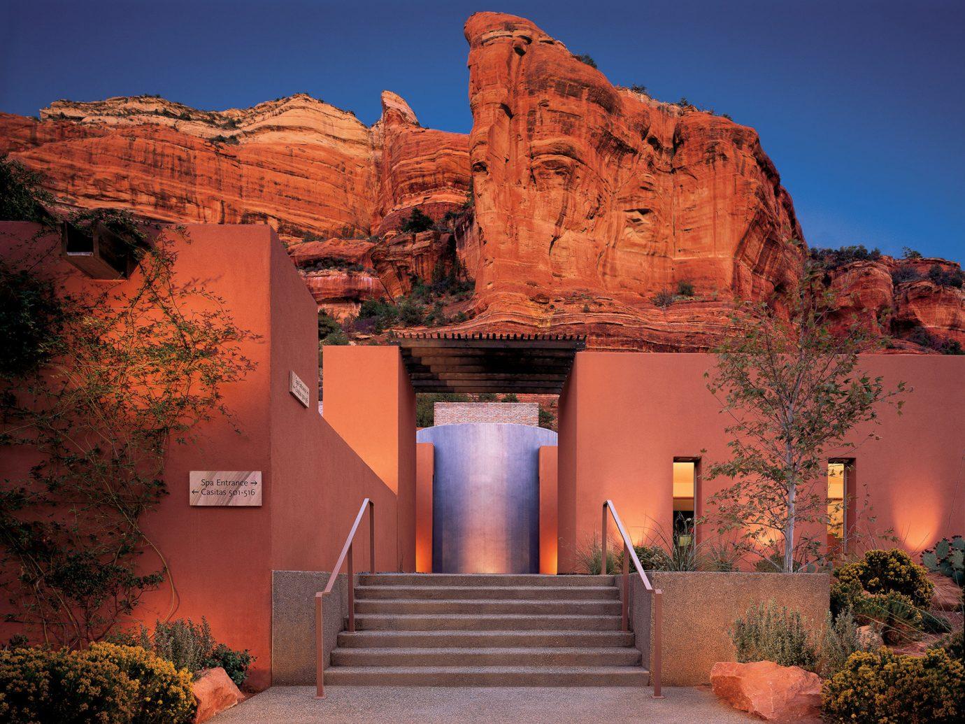 Trip Ideas tree outdoor valley canyon landmark Architecture arch rock landscape estate evening Sunset bushes stone