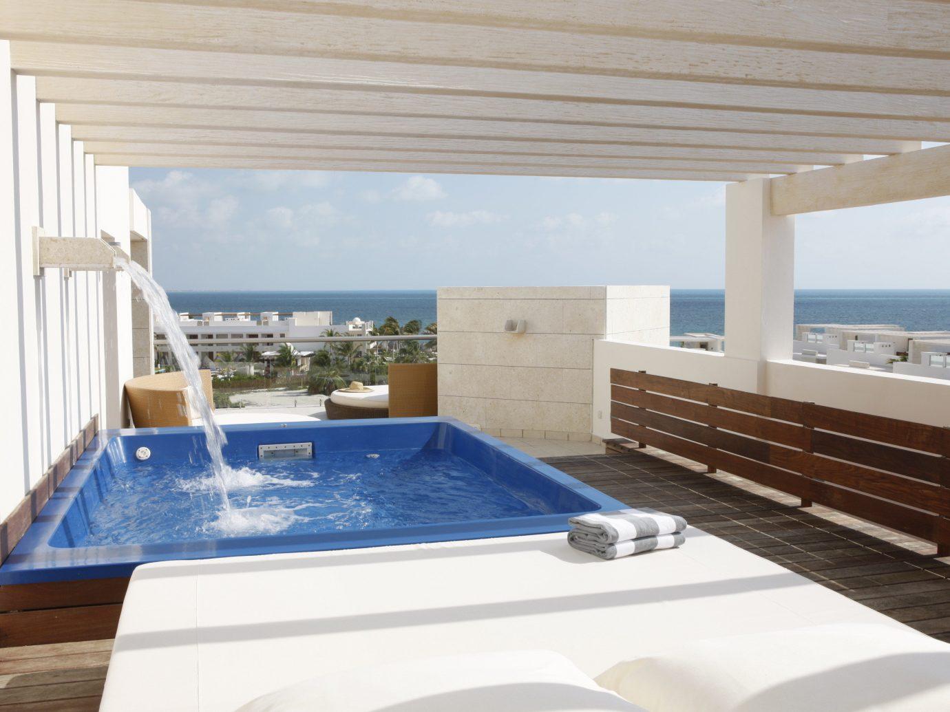 All-Inclusive Resorts Hotels Romance swimming pool property room window jacuzzi Villa interior design estate real estate daylighting apartment Deck tub