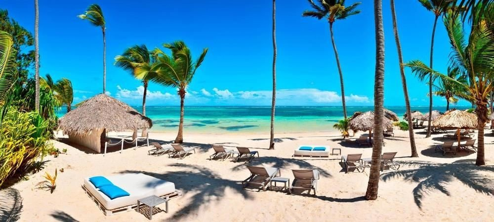 All-Inclusive Resorts Hotels Romance tree outdoor sky umbrella palm Beach leisure chair Resort caribbean vacation Nature shore shade Lagoon arecales estate bay Jungle lawn sandy Sea plant lined day several