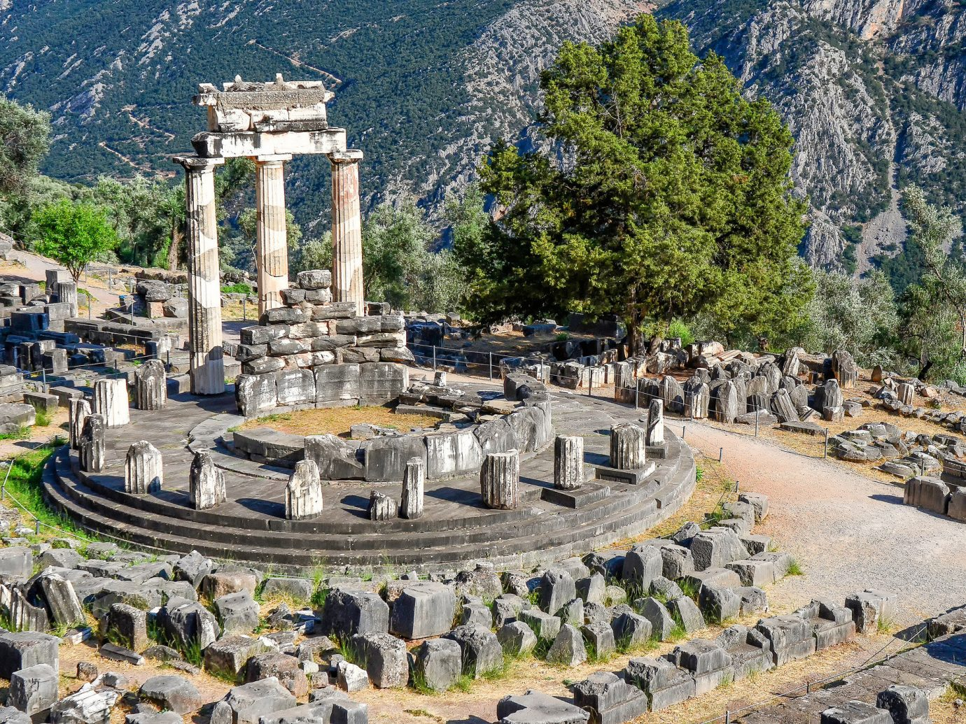 Arts + Culture Landmarks Trip Ideas tree outdoor mountain ground historic site ancient history landmark archaeological site Ruins tourist attraction unesco world heritage site ancient rome tourism ruin old stone