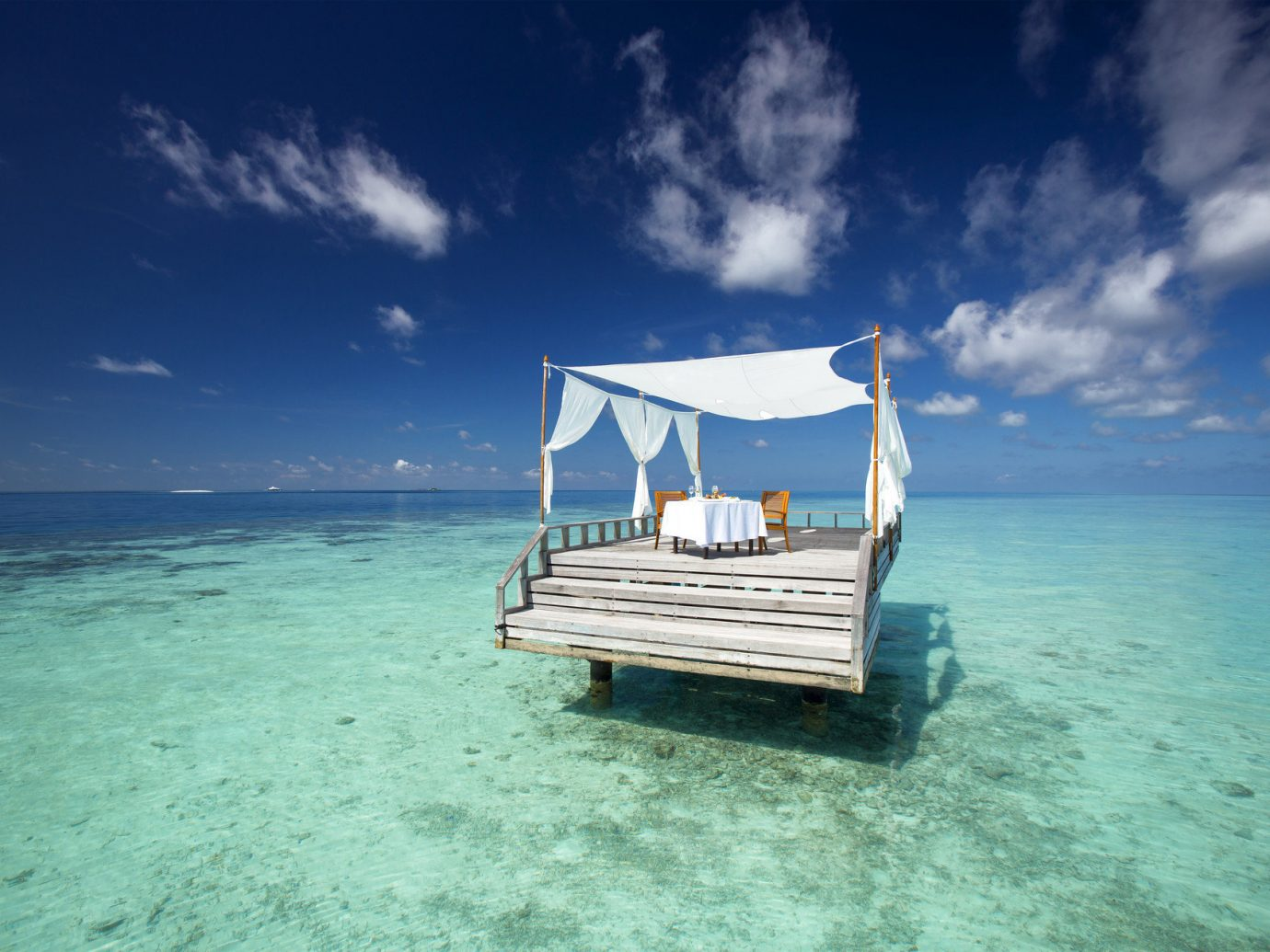 cabana calm clear water Dining Food + Drink isolation Luxury Ocean ocean view outdoor dining private private dining remote serene turquoise view sky water outdoor Sea blue caribbean vehicle horizon Beach cloud shore vacation Coast Island bay Lagoon wave ship cruise ship day