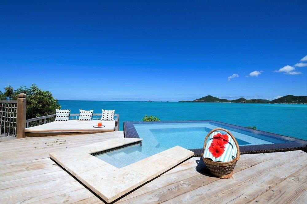 All-Inclusive Resorts caribbean sky ground water outdoor Sea leisure coastal and oceanic landforms vacation shore sunlounger outdoor furniture tourism Resort real estate bay swimming pool Boat estate landscape