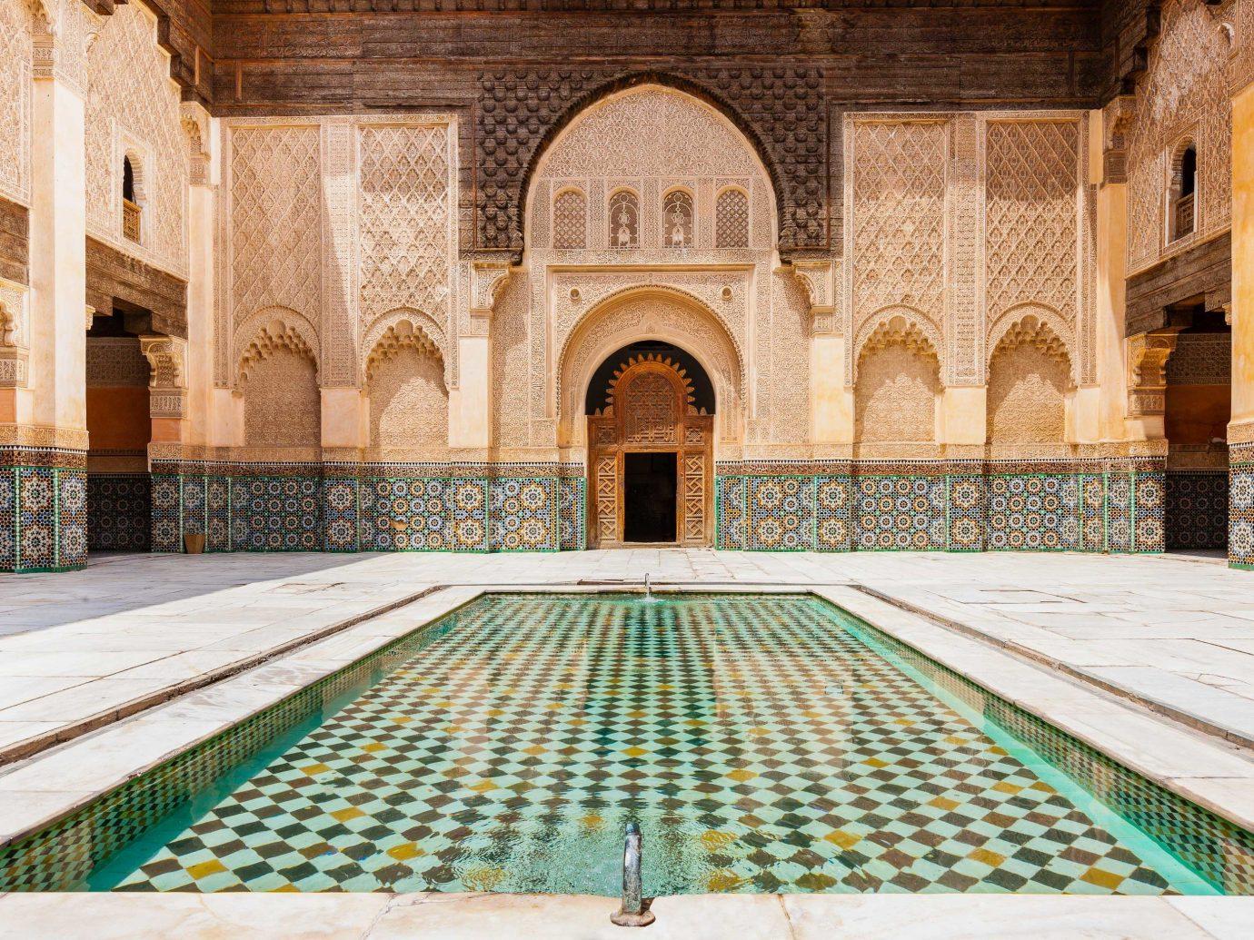 Arts + Culture Marrakech Morocco Style + Design arch Architecture building historic site symmetry place of worship caravanserai ancient history facade window column history