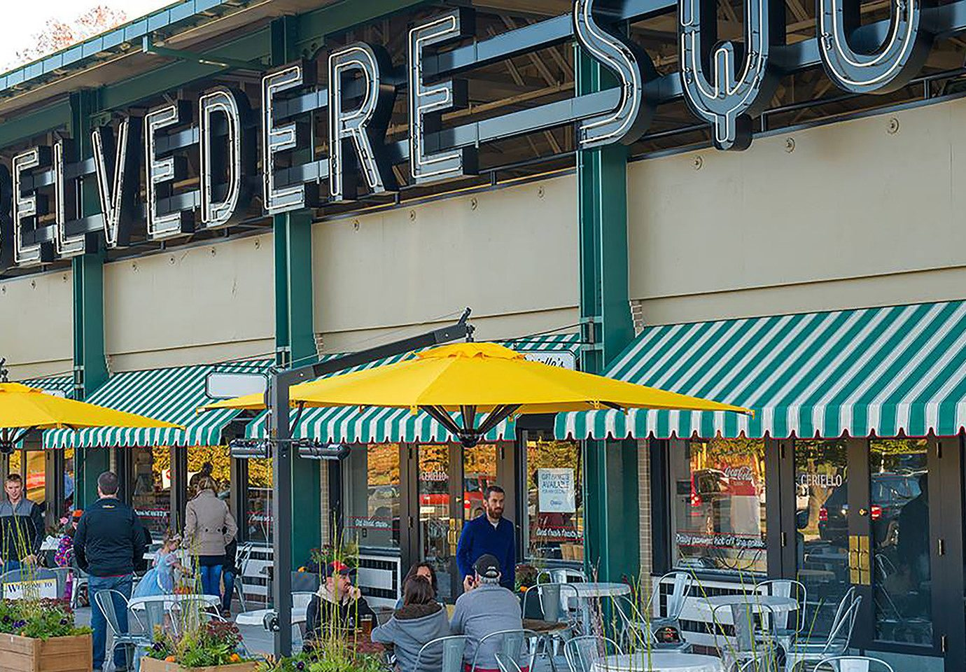 Food + Drink building outdoor marketplace public space market City neighbourhood shopping retail facade street restaurant grocery store store