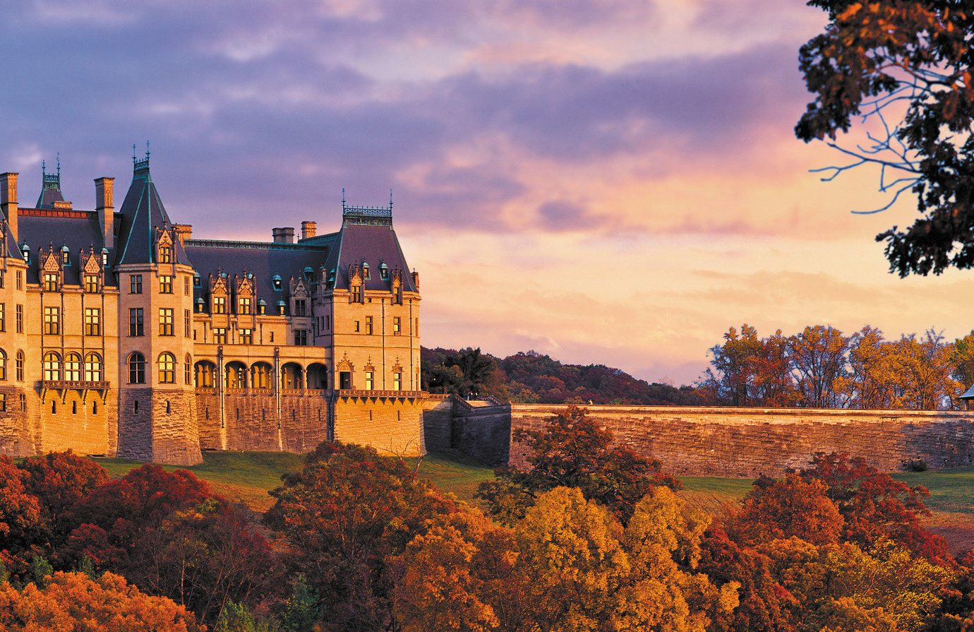 Architecture autumn building Elegant Exterior extravagant Fall fall colors Fall leaves fancy foliage golden hour Greenery Historic Hotels isolation Luxury Nature Outdoors regal remote Road Trips Scenic views sophisticated Sunset trees Trip Ideas view Weekend Getaways tree outdoor sky season City evening human settlement cityscape plant morning castle leaf woody plant flower reflection dusk château skyline