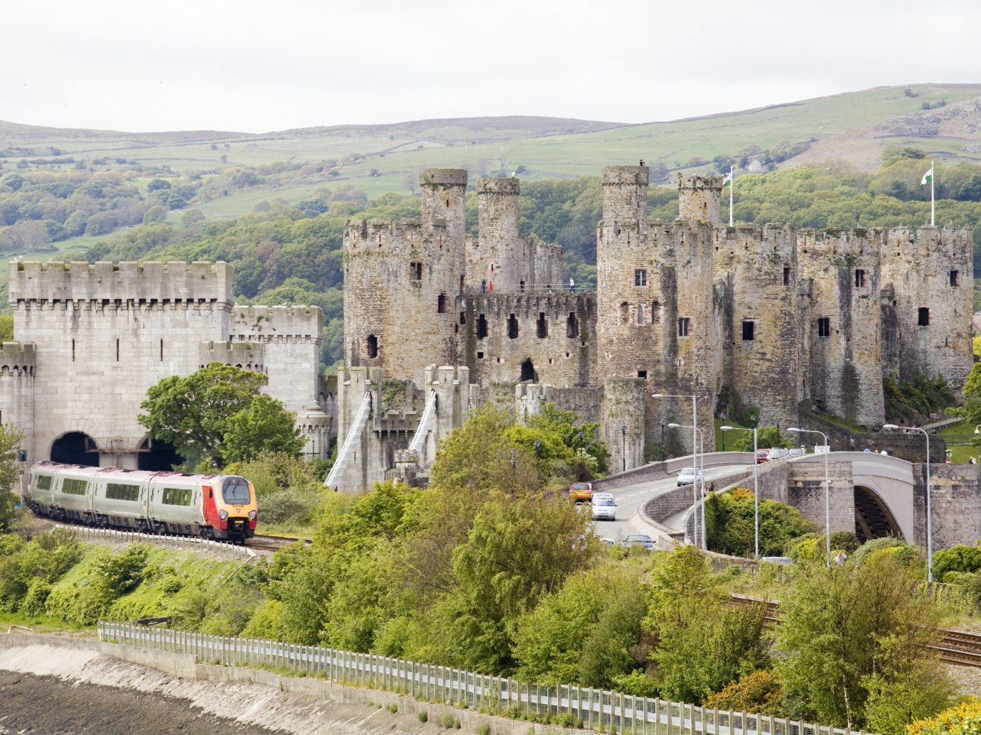 Trip Ideas mountain building outdoor castle fortification medieval architecture château historic site tree City tours sky stone traveling