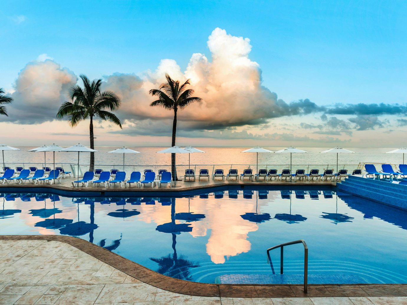All-inclusive Beachfront Hotels Lounge Luxury Romance sky water outdoor swimming pool vacation Sea Resort Ocean Beach estate arecales caribbean Lagoon bay shore several day