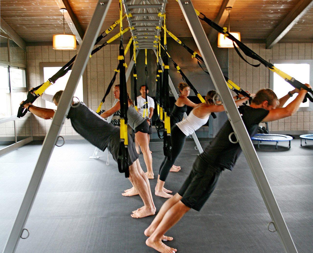 Health + Wellness Hotels Yoga Retreats floor person room aviation wing aircraft