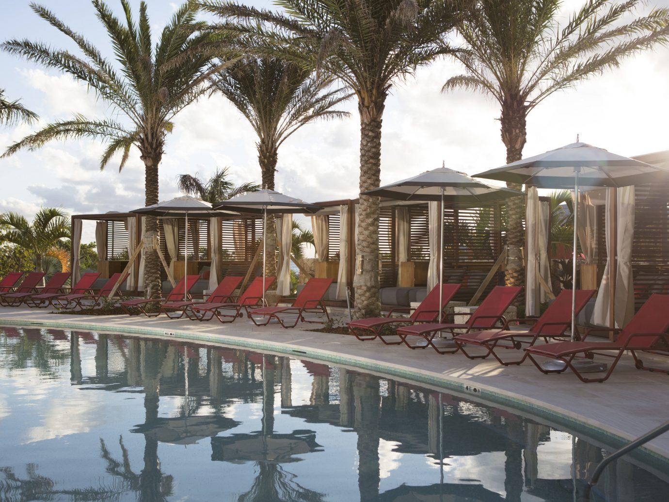 Hotels outdoor tree sky Resort vacation arecales waterway walkway palm several