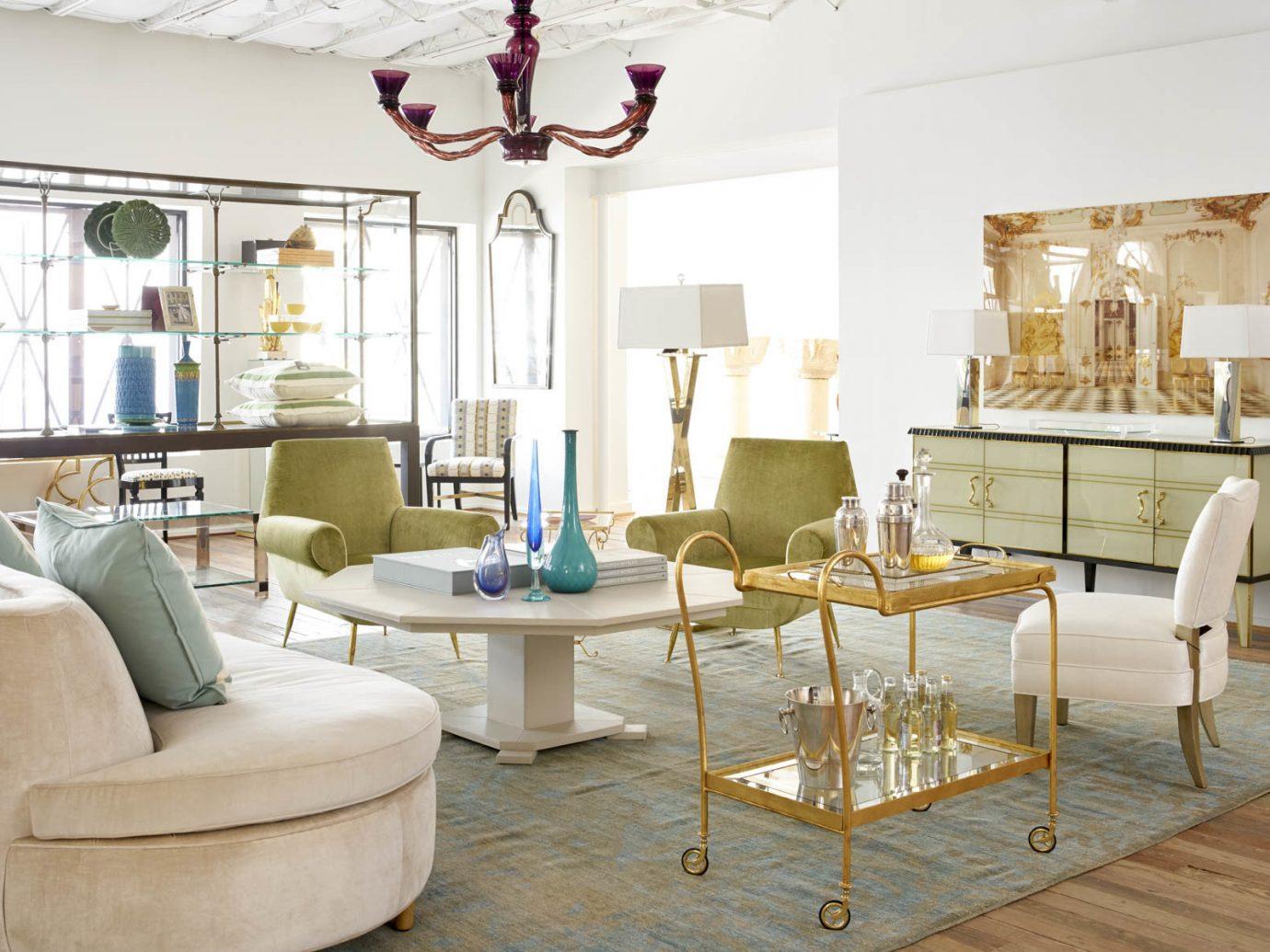 Jetsetter Guides indoor floor Living room dining room living room property home interior design estate furniture real estate Design table cottage area