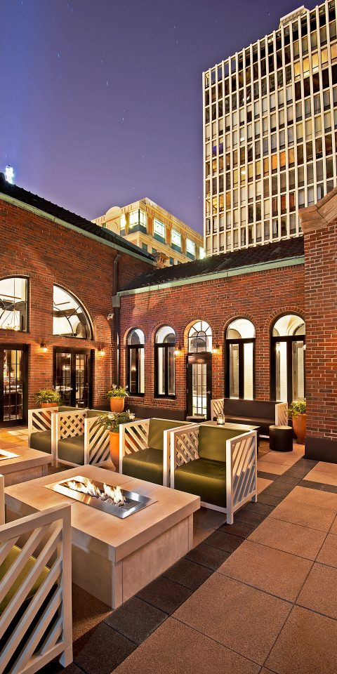 ambient lighting Bar brick wall Elegant extravagant fancy Food + Drink Hip industrial interior Lounge Luxury regal sophisticated Style + Design trendy estate house Architecture home interior design lighting mansion facade Courtyard Lobby