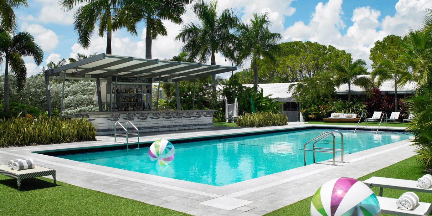 Trip Ideas tree outdoor grass swimming pool leisure property estate Villa backyard Resort vacation green home condominium Pool real estate park mansion