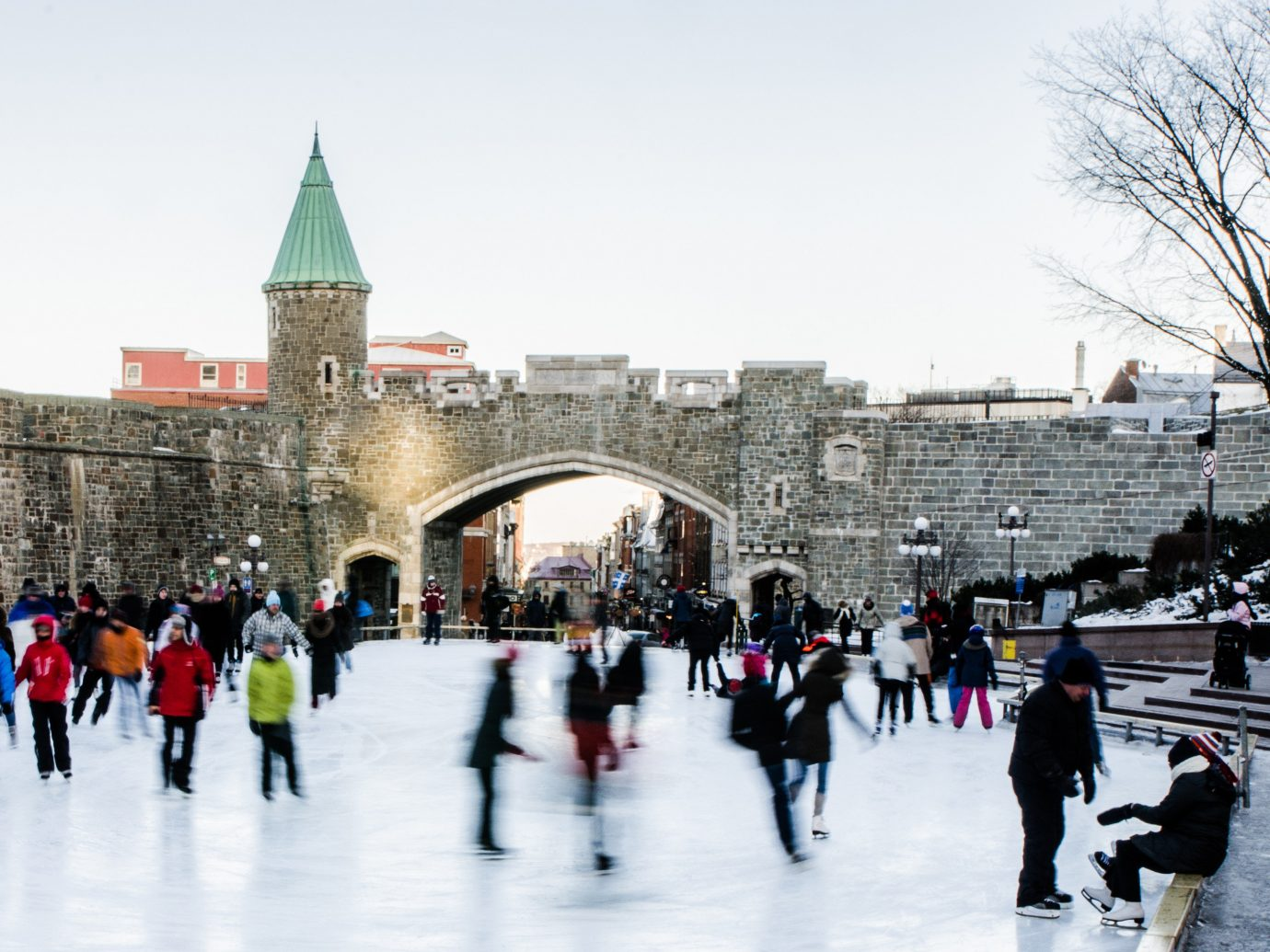 Boutique Hotels Canada Montreal Romance Toronto Trip Ideas rink outdoor building skiing snow people Winter group urban area City tree ice freezing town square tourism tourist attraction recreation pedestrian ice rink fun plaza sky Ice Skating crowd line ski slope