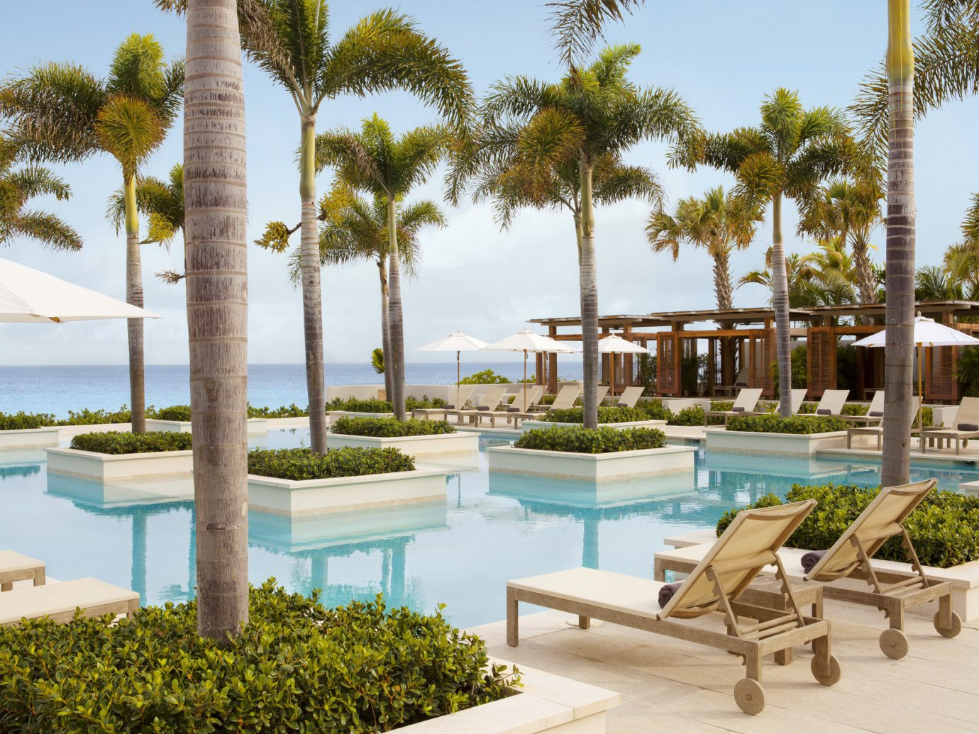 Trip Ideas tree sky outdoor leisure property Resort swimming pool condominium estate vacation plant arecales palm Villa home park caribbean real estate palm family