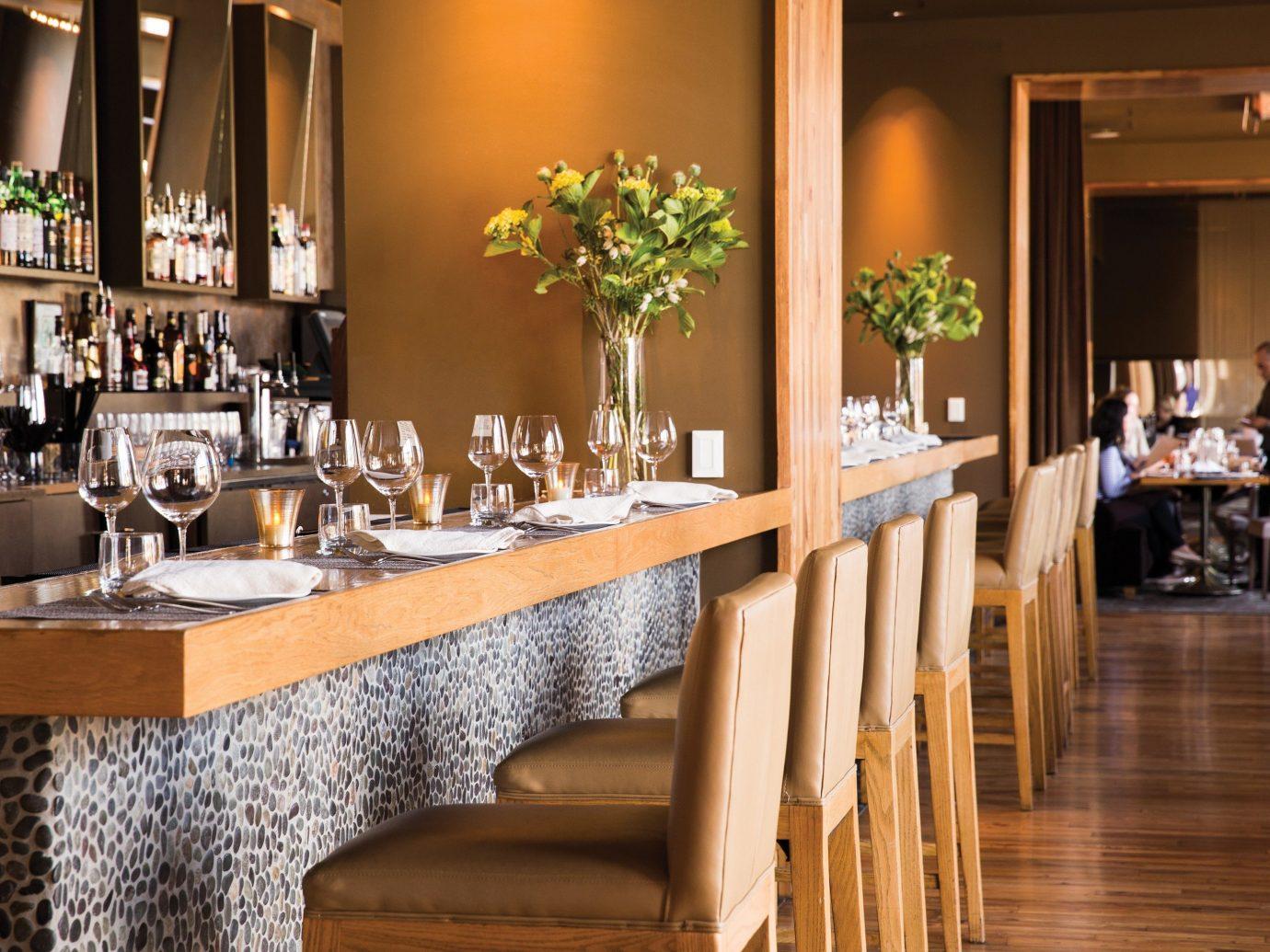 Food + Drink floor indoor dining room room restaurant meal interior design estate Bar wood furniture decorated