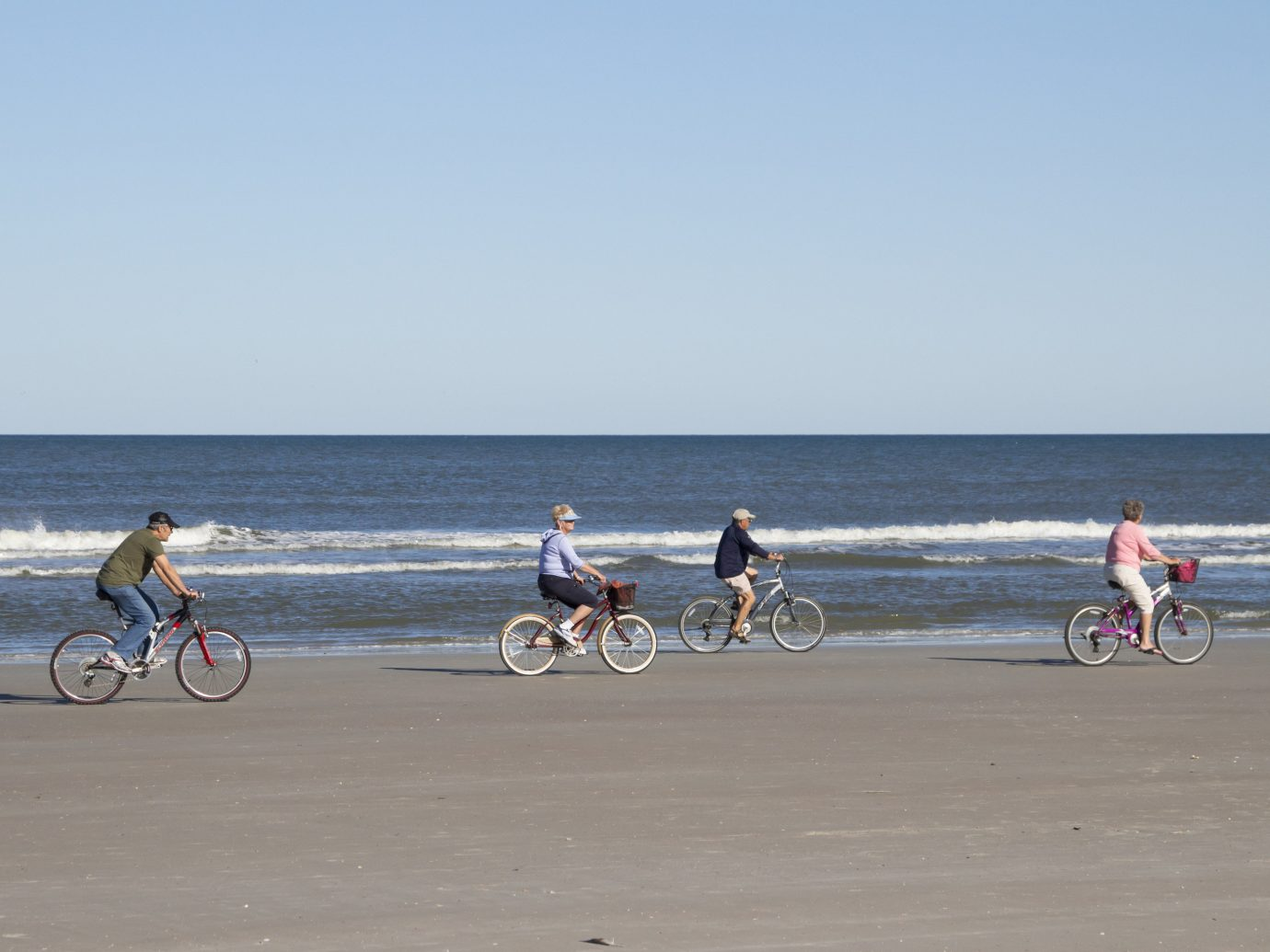 Road Trips Trip Ideas sky outdoor road land vehicle bicycle body of water Beach cycling Sea riding sand shore people vehicle coastal and oceanic landforms road bicycle recreation vacation Coast sports equipment endurance sports boardwalk tourism hybrid bicycle group cycle sport Ocean mountain bike sandy