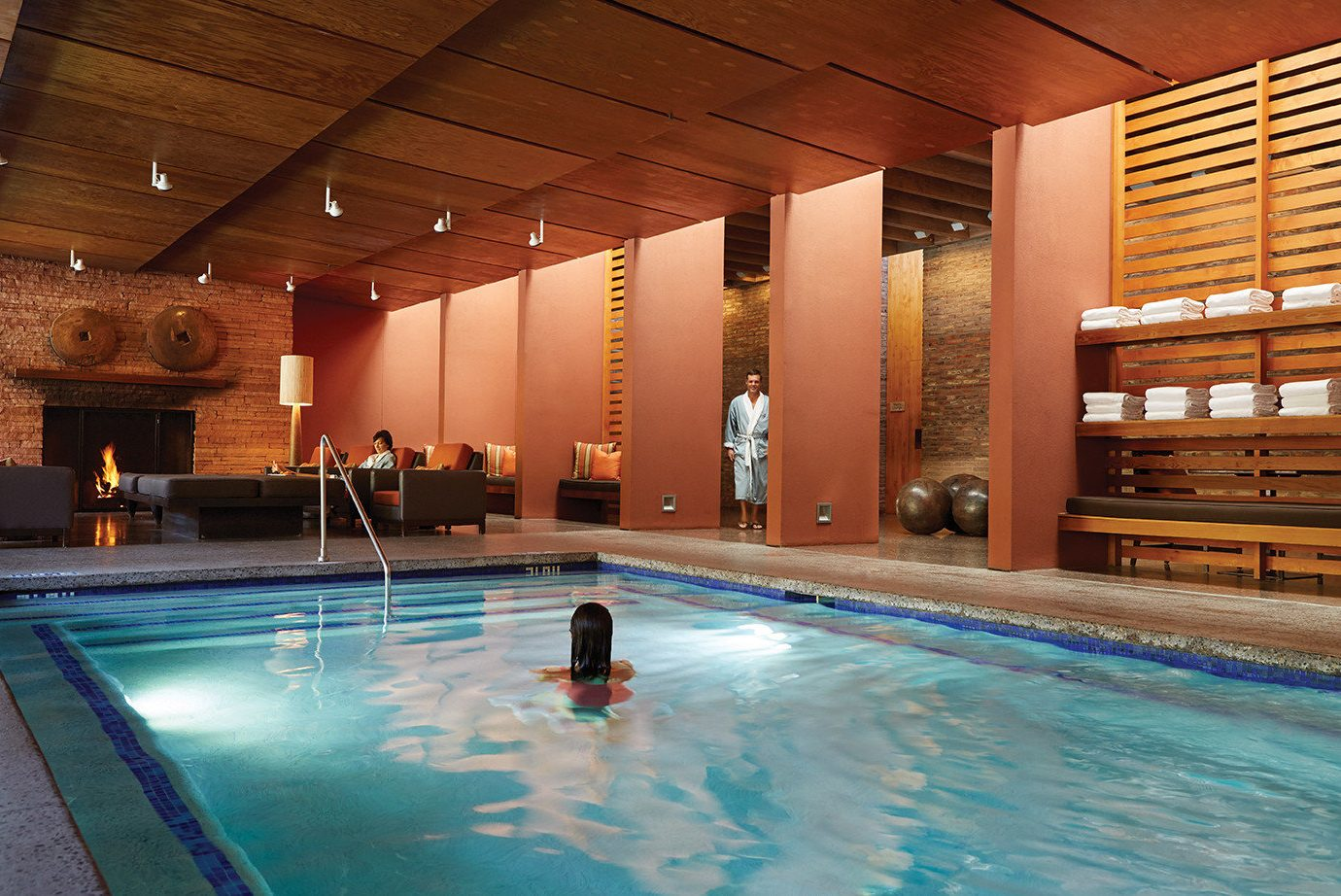 ambient lighting cozy Fireplace indoor pool Lounge Luxury people Pool relaxation Spa swimming warm woman women ceiling indoor swimming pool leisure water sport leisure centre estate billiard room Resort