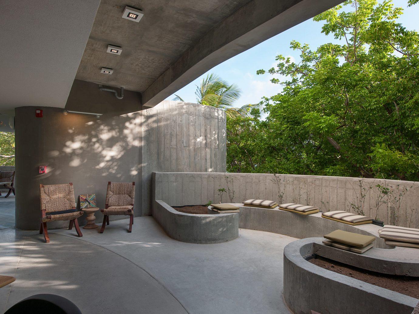 Boutique Design Hip Living Modern Trip Ideas tree property Architecture estate swimming pool tourist attraction interior design stone