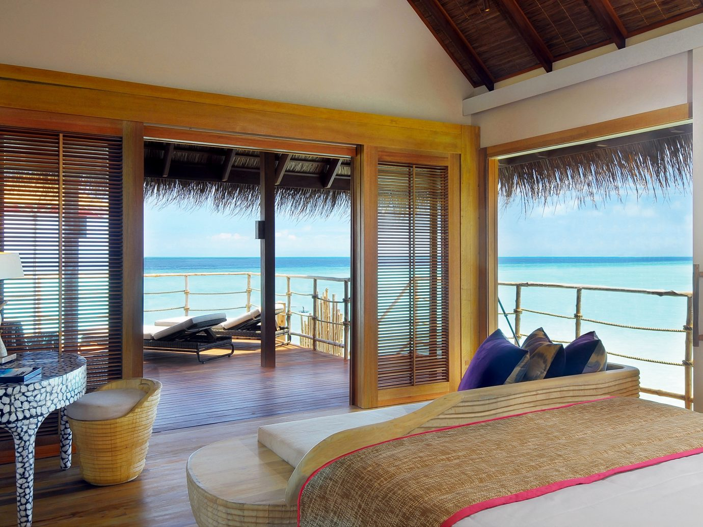 All-Inclusive Resorts Beachfront Bedroom Hotels Island Luxury Luxury Travel Overwater Bungalow Romance Romantic Suite Waterfront indoor window wall room property bed Resort hotel estate ceiling Villa real estate vacation condominium interior design cottage apartment swimming pool furniture overlooking