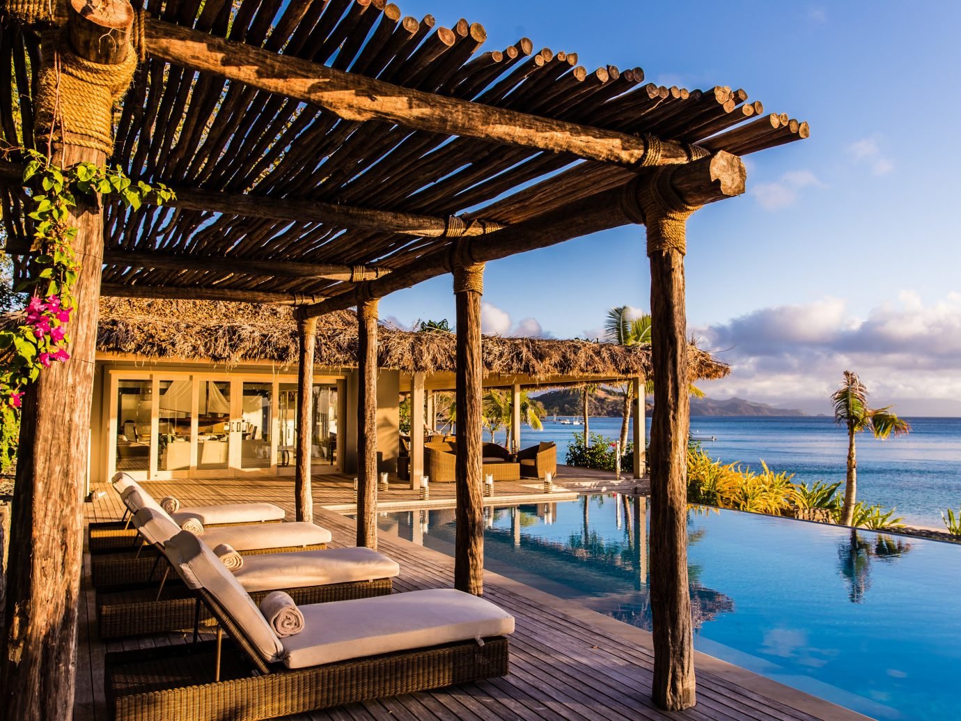 All-Inclusive Resorts Hotels Luxury Travel sky outdoor Resort property real estate leisure estate vacation outdoor structure arecales Villa swimming pool palm tree home cottage eco hotel tropics hacienda overlooking
