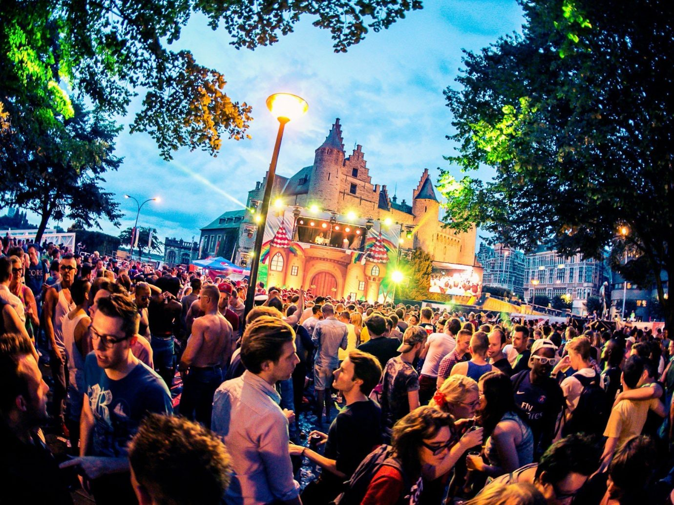 Trip Ideas tree person outdoor crowd people street group festival event audience Nature crowded gathered line surrounded
