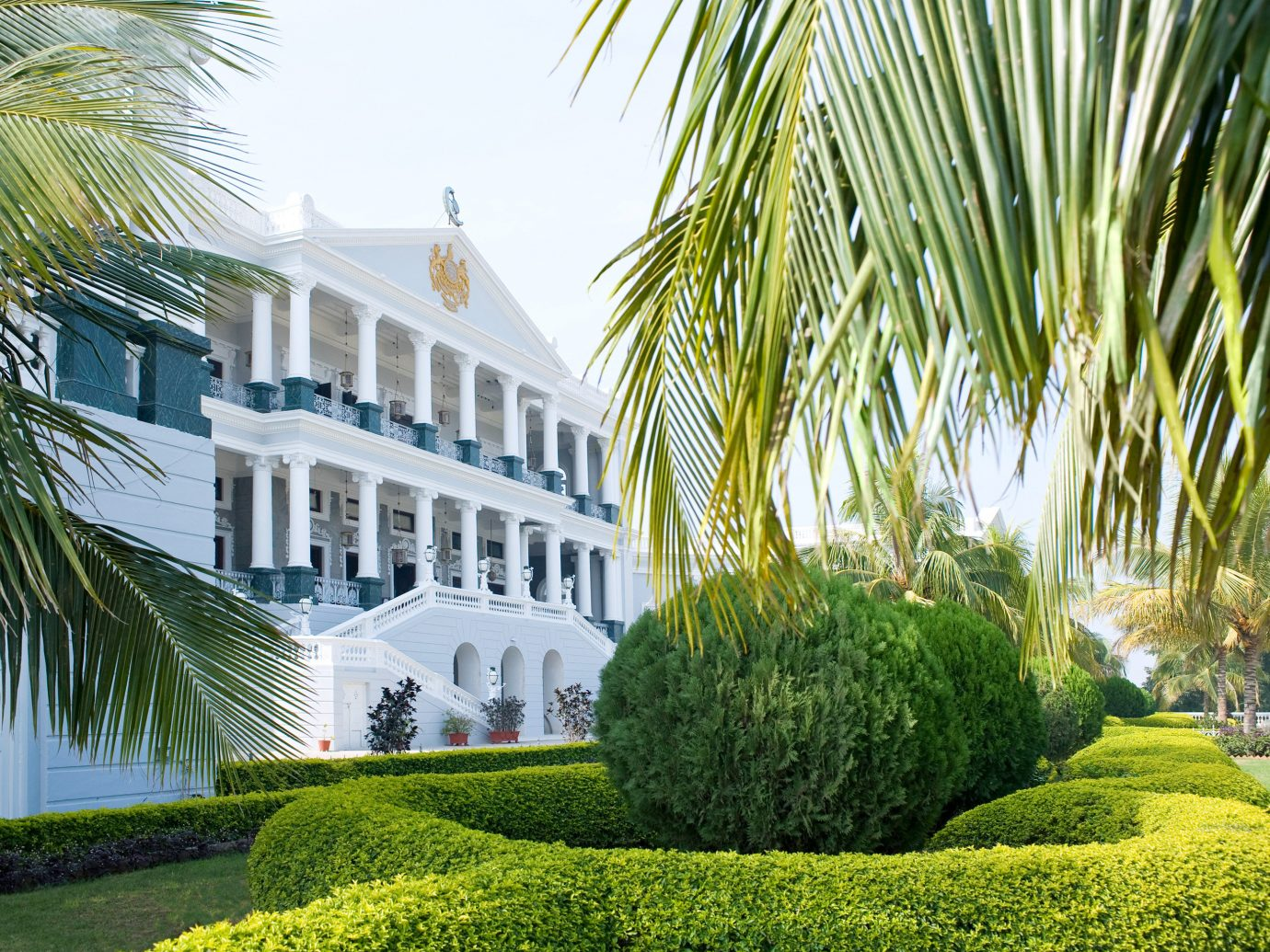 Architecture Buildings Design Elegant Exterior Grounds Hotels Luxury tree outdoor grass property green house estate botany Garden palm home plant lawn arecales Courtyard condominium backyard mansion Resort facade palm family yard plantation