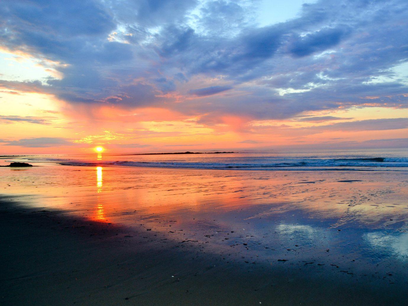 sky outdoor water Sunset sunrise horizon Sea afterglow shore Beach cloud dawn Ocean reflection clouds morning dusk Sun Nature Coast evening sunlight wave wind wave setting cloudy