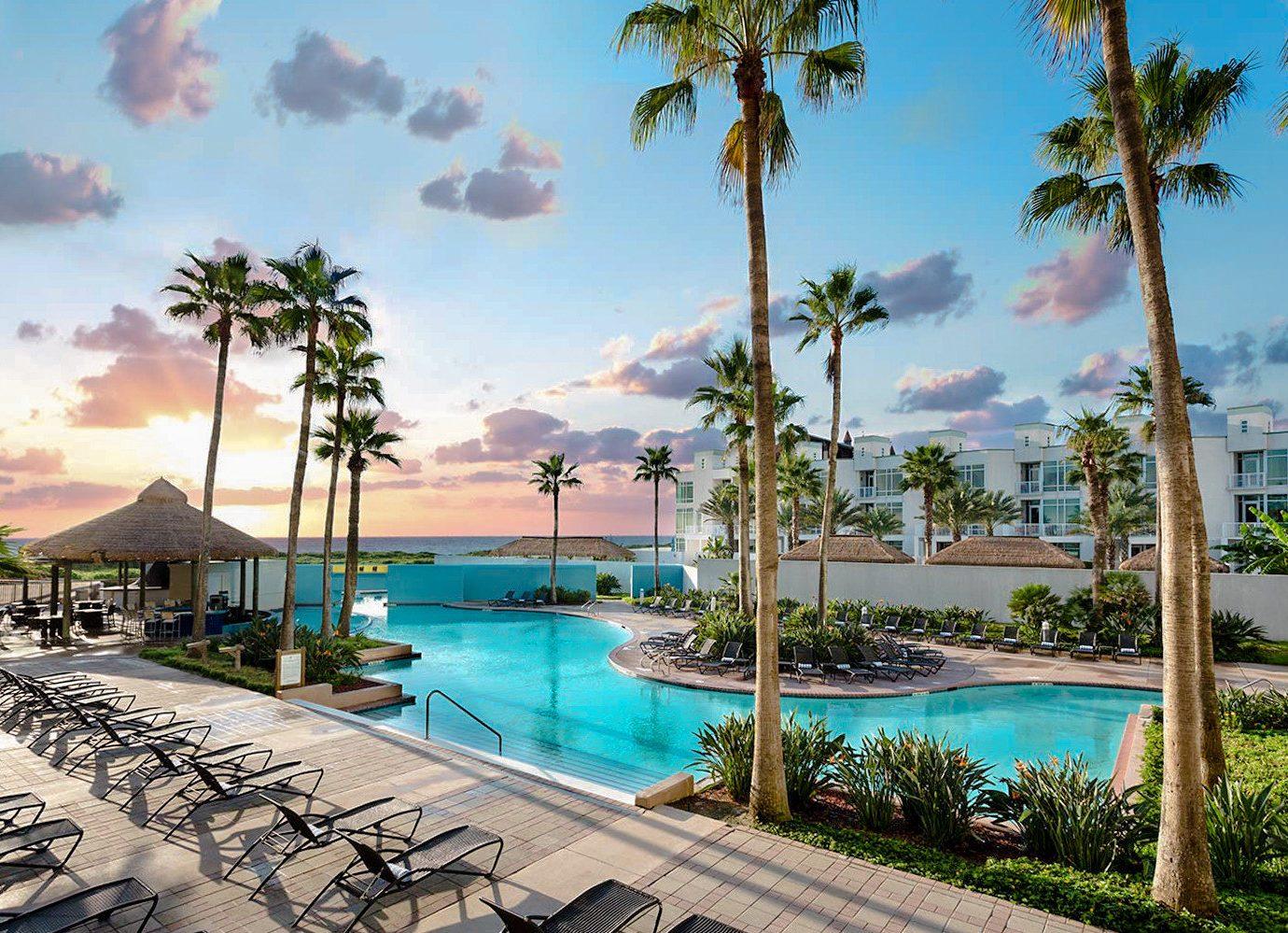 Trip Ideas tree sky outdoor palm leisure Resort property swimming pool vacation Beach caribbean estate arecales condominium Ocean bay Sea Lagoon marina lined shore area Garden several sandy
