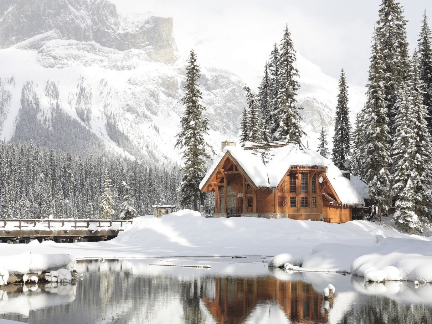 Hotels Trip Ideas snow outdoor tree sky Winter Nature mountain wilderness weather covered season geological phenomenon mountain range freezing ice Resort Forest surrounded
