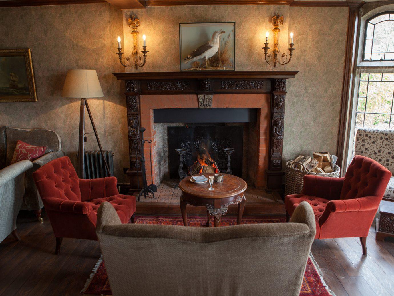 Trip Ideas floor indoor Living room living room property estate Fireplace cottage home interior design furniture Villa mansion real estate Suite