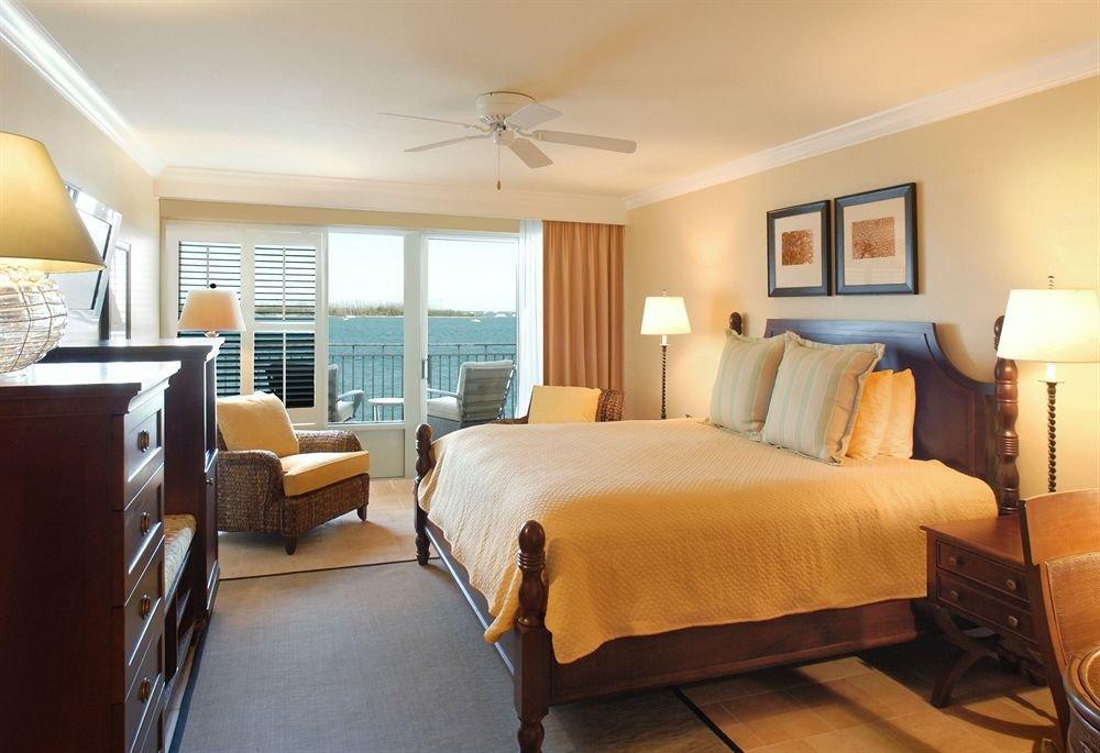 Bedroom Elegant Florida Hotels Luxury Suite indoor floor ceiling wall room bed sofa hotel window property estate real estate cottage interior design living room apartment condominium furniture