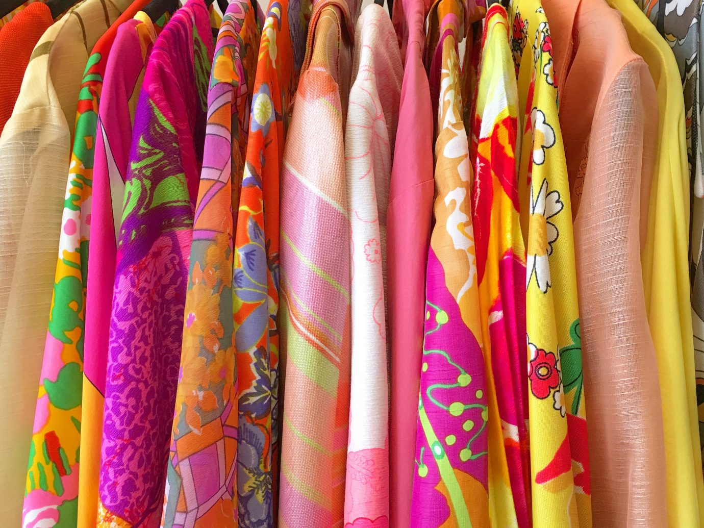 Jetsetter Guides color indoor clothing different yellow bunch row rack hanging many pattern arm fashion accessory lots textile hand finger various clothes line assortment colorful several lined colored