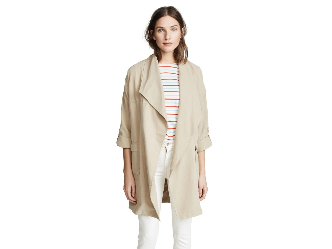 Packing Tips Spring Travel Style + Design Travel Shop clothing wearing posing person standing coat outerwear fashion model suit costume beige neck dressed