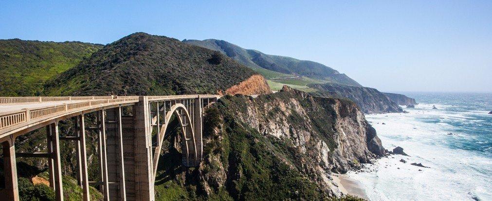 Jetsetter Guides mountain outdoor sky rock bridge building Coast cliff terrain traveling hillside arch