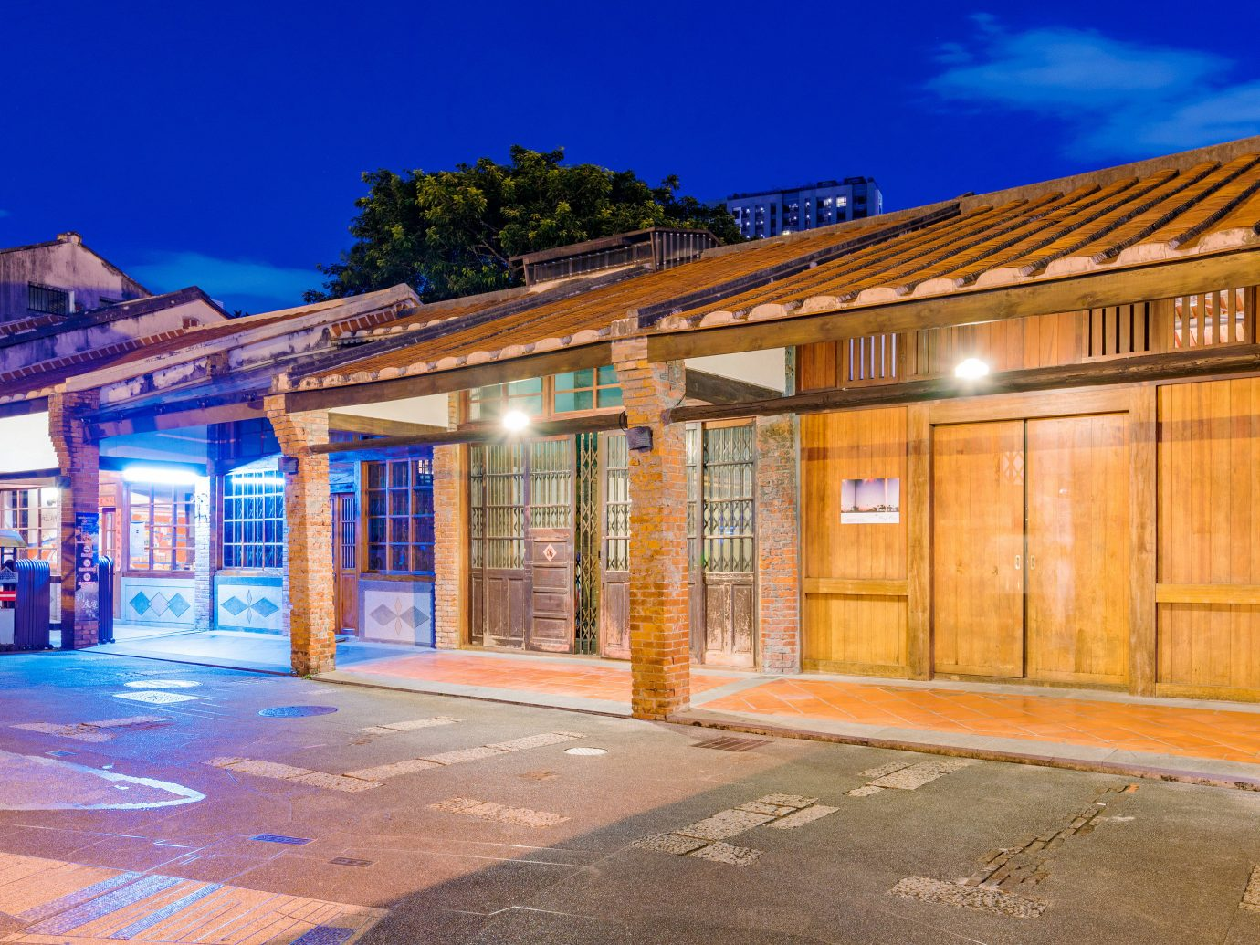 Arts + Culture Taipei Travel Tips Trip Ideas property sky Town home Architecture real estate residential area house facade window evening City estate building night shed