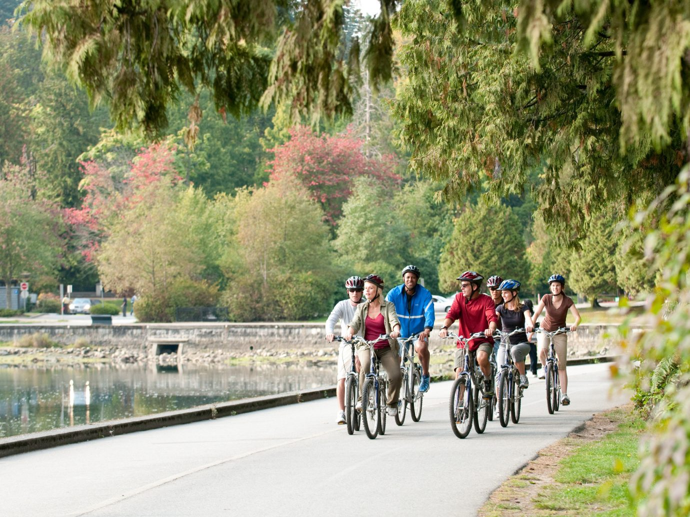 Health + Wellness Trip Ideas tree outdoor road riding cycling bicycle people street sports tourism vehicle outdoor recreation road cycling tours recreation endurance sports way cycle sport waterway mountain bike traveling carriage bicycling