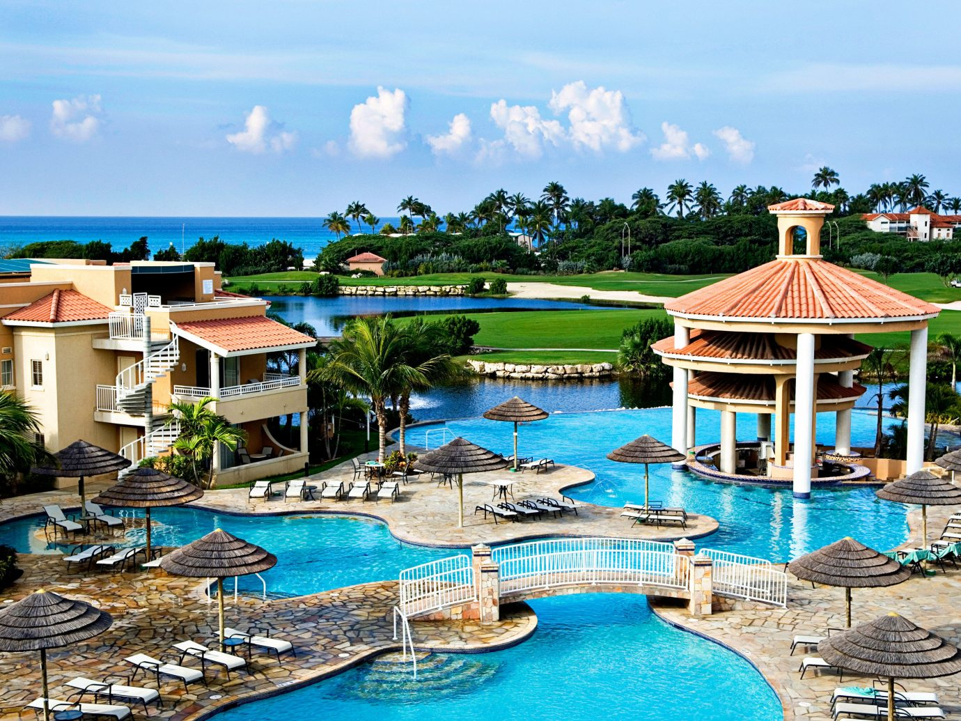 Hotels sky outdoor leisure chair Resort geographical feature swimming pool property vacation estate Harbor Beach resort town Sea caribbean Water park bay Village Lagoon amusement park blue set several Island