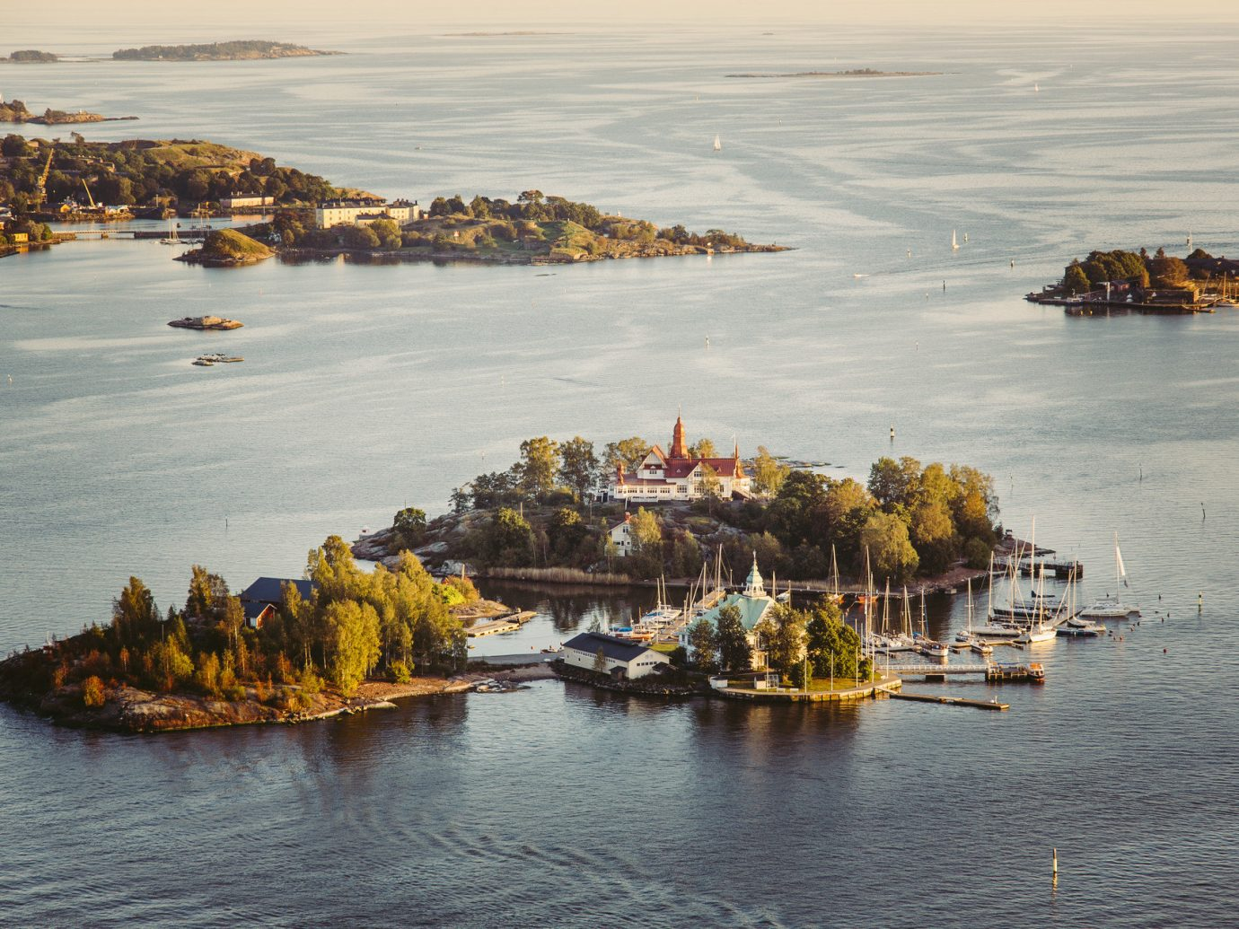 Finland Trip Ideas water outdoor Boat Sea shore Coast Harbor body of water Ocean scene reflection Beach bay vehicle boating Nature wave cove islet watercraft several