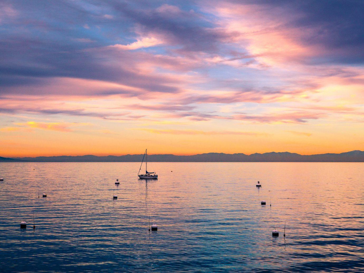 Trip Ideas water sky outdoor Sunset Boat Sea horizon afterglow sunrise cloud shore dawn morning dusk Ocean evening reflection Lake loch distance