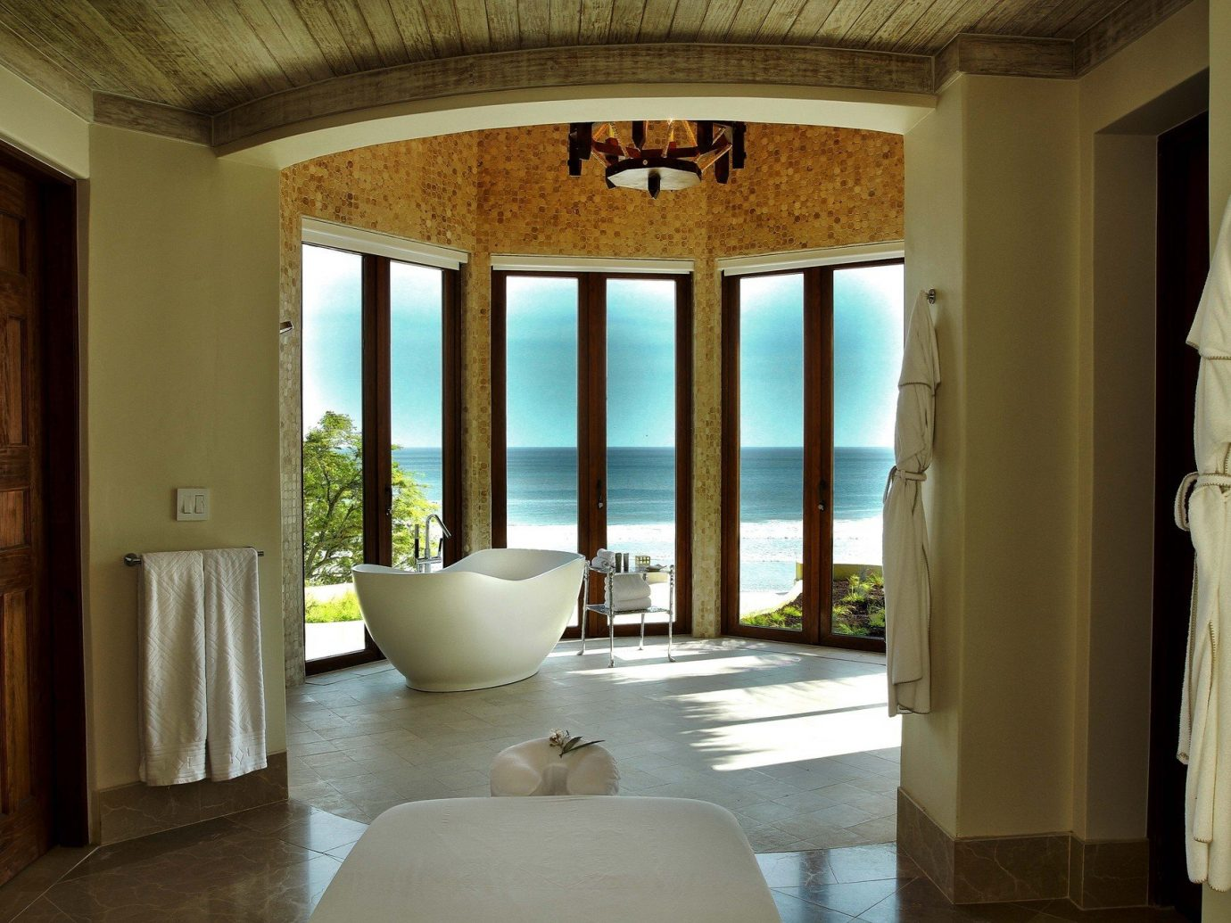 Bath bathroom beach house calm Elegant Hotels Luxury Ocean ocean view open-air regal remote Romance Rustic serene sophisticated Tropical turquoise view windows indoor wall floor house window room property ceiling estate building home Architecture interior design mansion wood living room Design Villa apartment hall Bedroom furniture