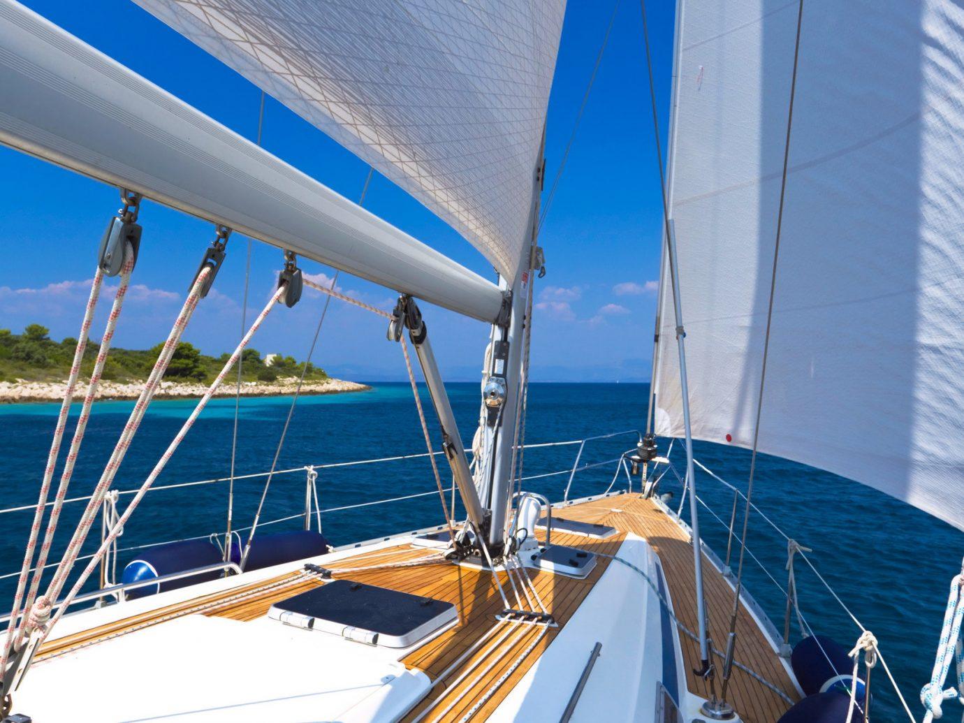 Offbeat sky Boat outdoor water sail vehicle sailboat watercraft sailing ship sailing vessel yacht ship transport mast passenger ship Sea sports sailing blue windsports docked