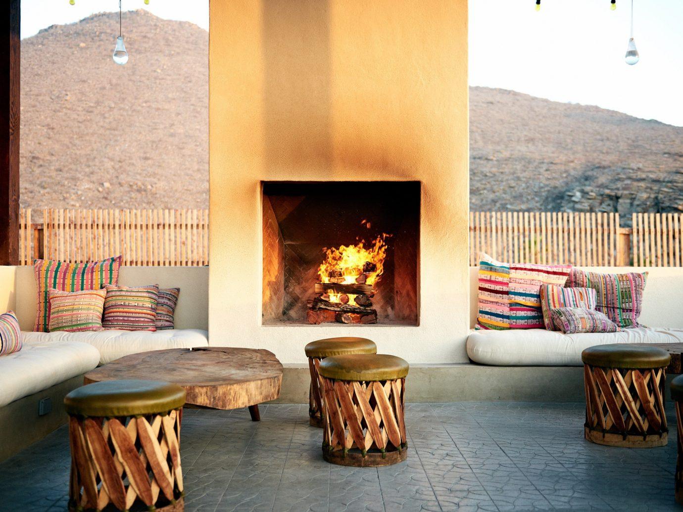 Beach Honeymoon Hotels Mexico Romance Tulum Living indoor floor hearth room living room interior design Fireplace furniture table wood burning stove real estate wood stone