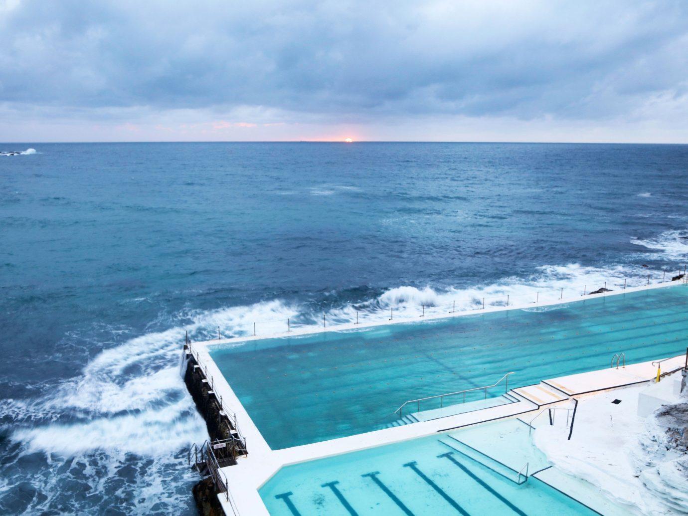 Offbeat water sky outdoor Sea Ocean horizon caribbean vacation wind wave vehicle Coast shore cape wave