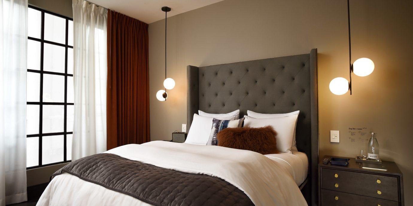 News bed indoor wall room Bedroom hotel ceiling property scene Suite interior design cottage estate real estate floor