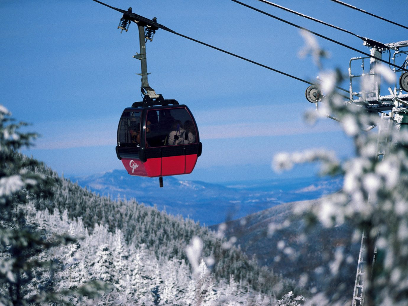 Hotels Weekend Getaways outdoor sky snow cable car ski tow vehicle helicopter transport aircraft atmosphere of earth rotorcraft aviation mountain range slope day